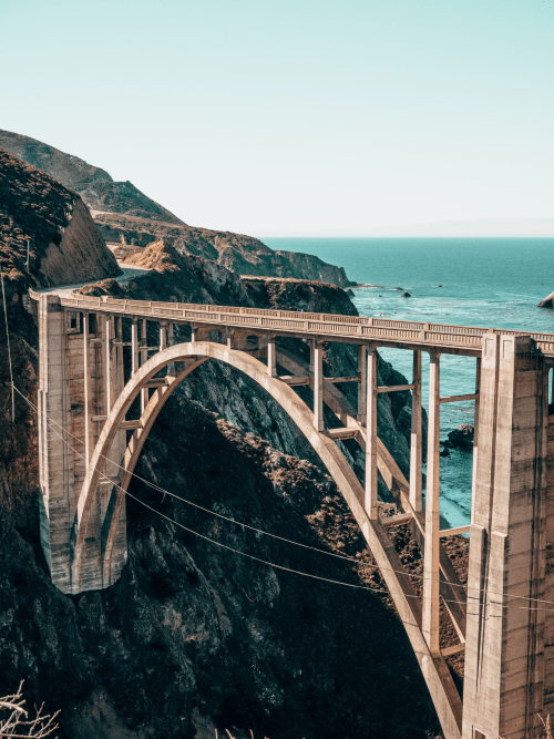 An unsplash image with a sky and a bridge, this image is taller than it is wide.