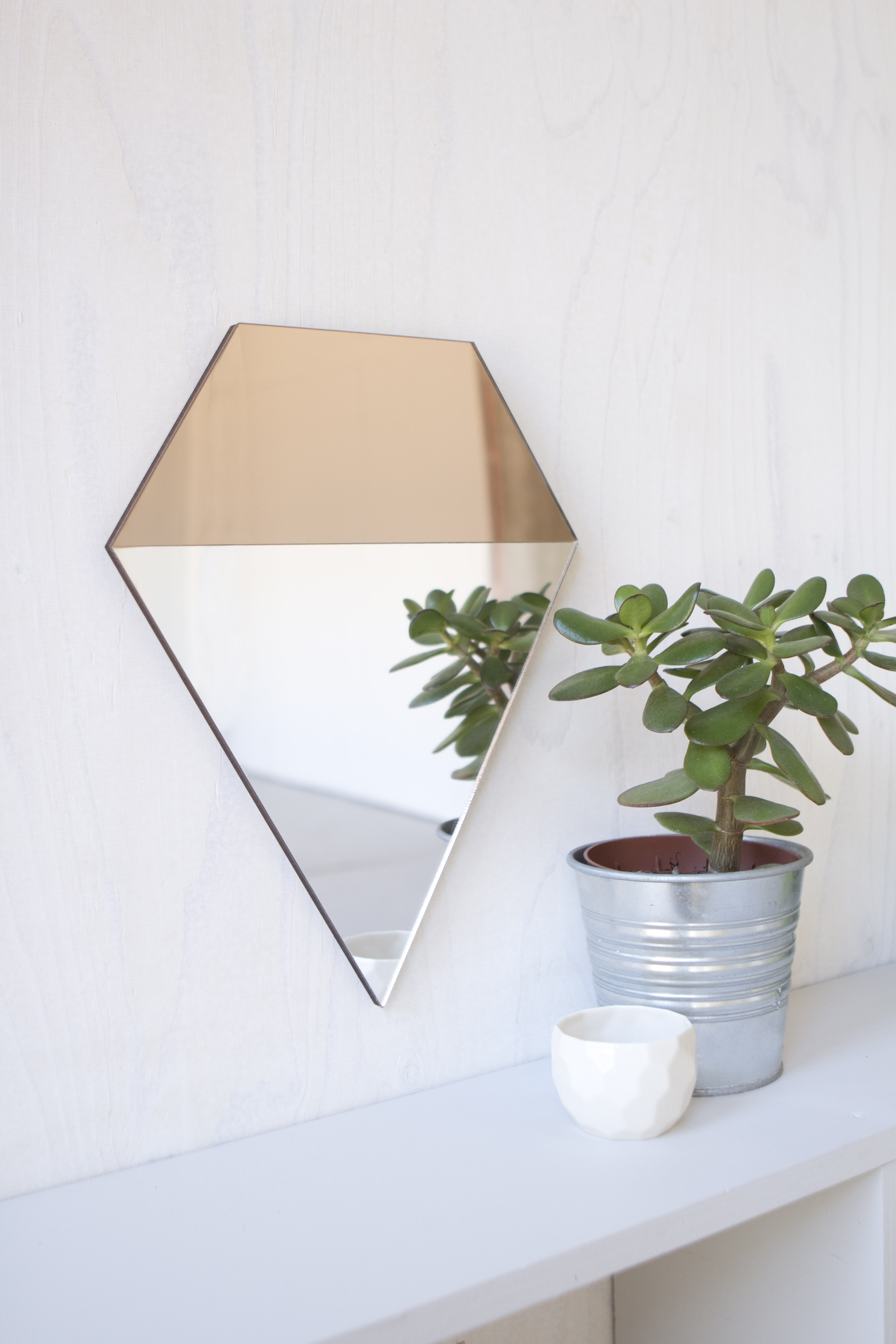 Prism Mirror, hangs from three points to transform its look