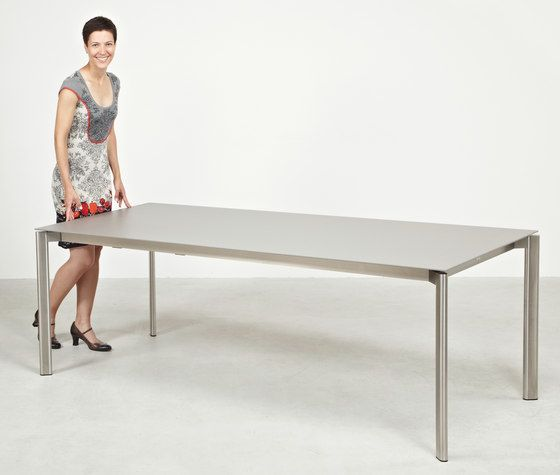 https://res.cloudinary.com/clippings/image/upload/t_big/dpr_auto,f_auto,w_auto/v1/product_bases/swing-front-slide-extension-table-by-fischer-mobel-fischer-mobel-clippings-3594562.jpg