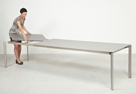 https://res.cloudinary.com/clippings/image/upload/t_big/dpr_auto,f_auto,w_auto/v1/product_bases/swing-front-slide-extension-table-by-fischer-mobel-fischer-mobel-clippings-3594622.jpg