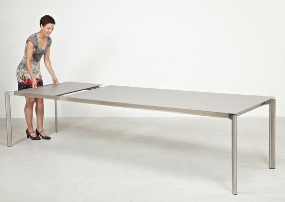 https://res.cloudinary.com/clippings/image/upload/t_big/dpr_auto,f_auto,w_auto/v1/product_bases/swing-front-slide-extension-table-by-fischer-mobel-fischer-mobel-clippings-3594642.jpg