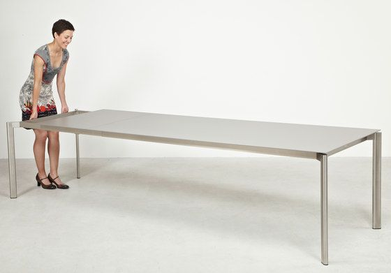 https://res.cloudinary.com/clippings/image/upload/t_big/dpr_auto,f_auto,w_auto/v1/product_bases/swing-front-slide-extension-table-by-fischer-mobel-fischer-mobel-clippings-3594662.jpg