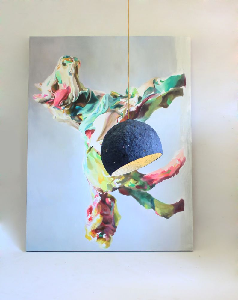 Pluto pendant lamp with the pictures of Jesus Angel Bordetas in the background
