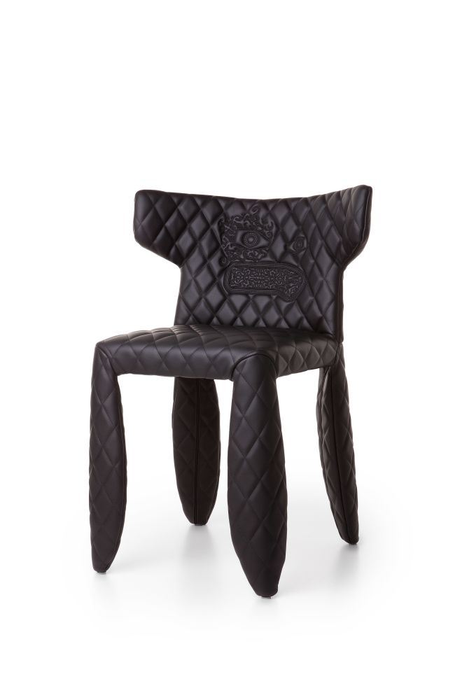https://res.cloudinary.com/clippings/image/upload/t_big/dpr_auto,f_auto,w_auto/v1497267127/products/monster-dining-chair-moooi-faux-leather-with-armrest-with-embroidery-moooi-marcel-wanders-clippings-9039101.jpg