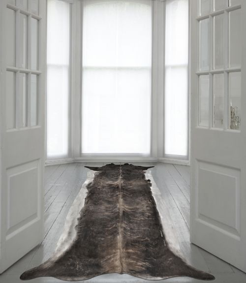 https://res.cloudinary.com/clippings/image/upload/t_big/dpr_auto,f_auto,w_auto/v1505743782/products/super-long-stretched-cowhide-rug-mineheart-mineheart-clippings-9464231.jpg