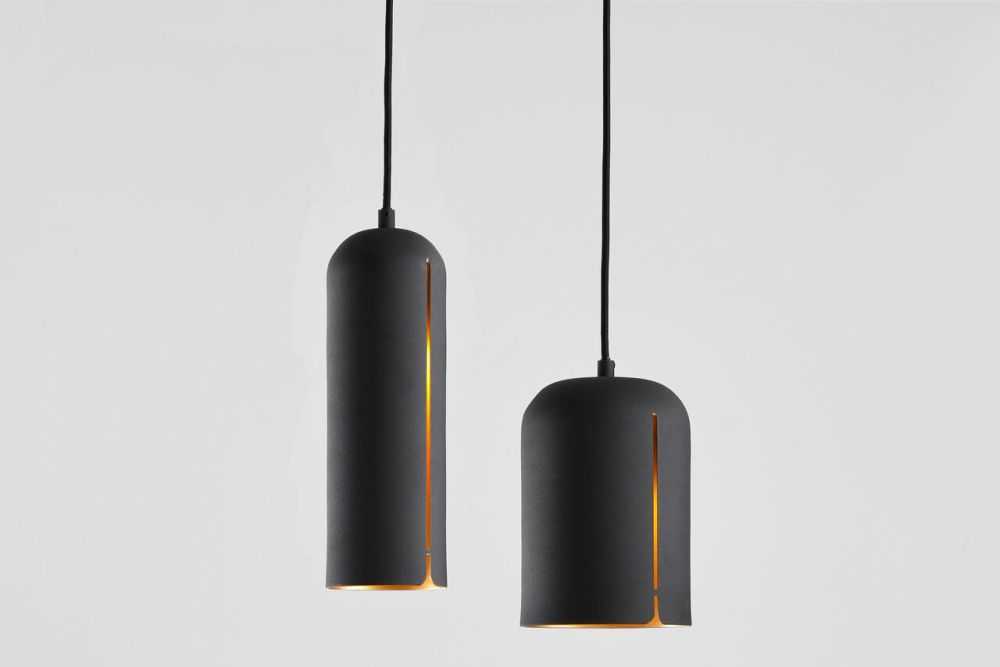 https://res.cloudinary.com/clippings/image/upload/t_big/dpr_auto,f_auto,w_auto/v1507191137/products/gap-pendant-light-tall-woud-studio-nur-clippings-9509911.jpg