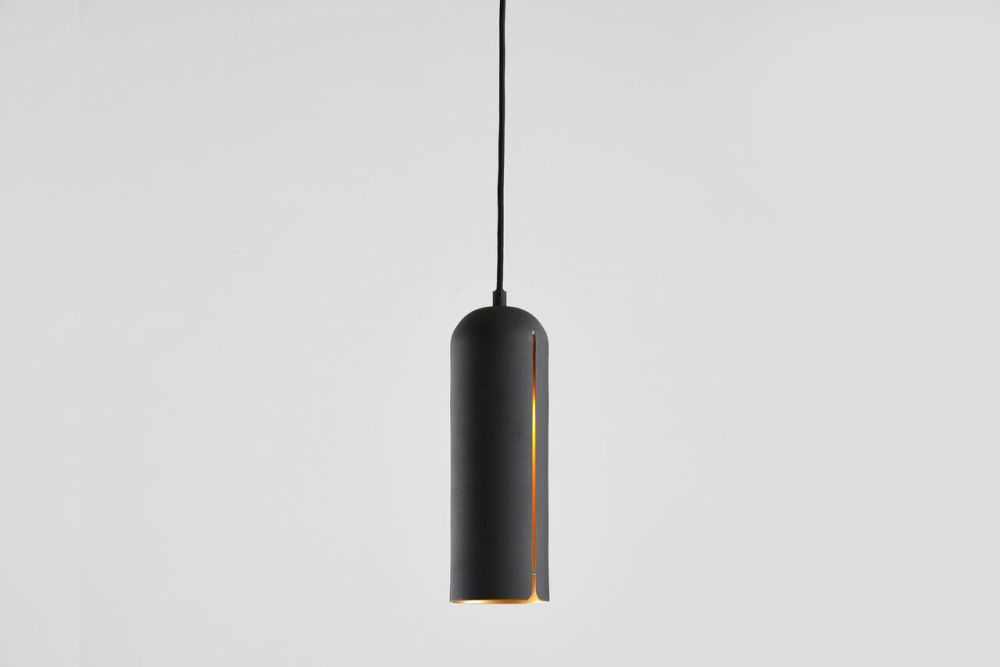 https://res.cloudinary.com/clippings/image/upload/t_big/dpr_auto,f_auto,w_auto/v1507191143/products/gap-pendant-light-tall-woud-studio-nur-clippings-9509931.jpg