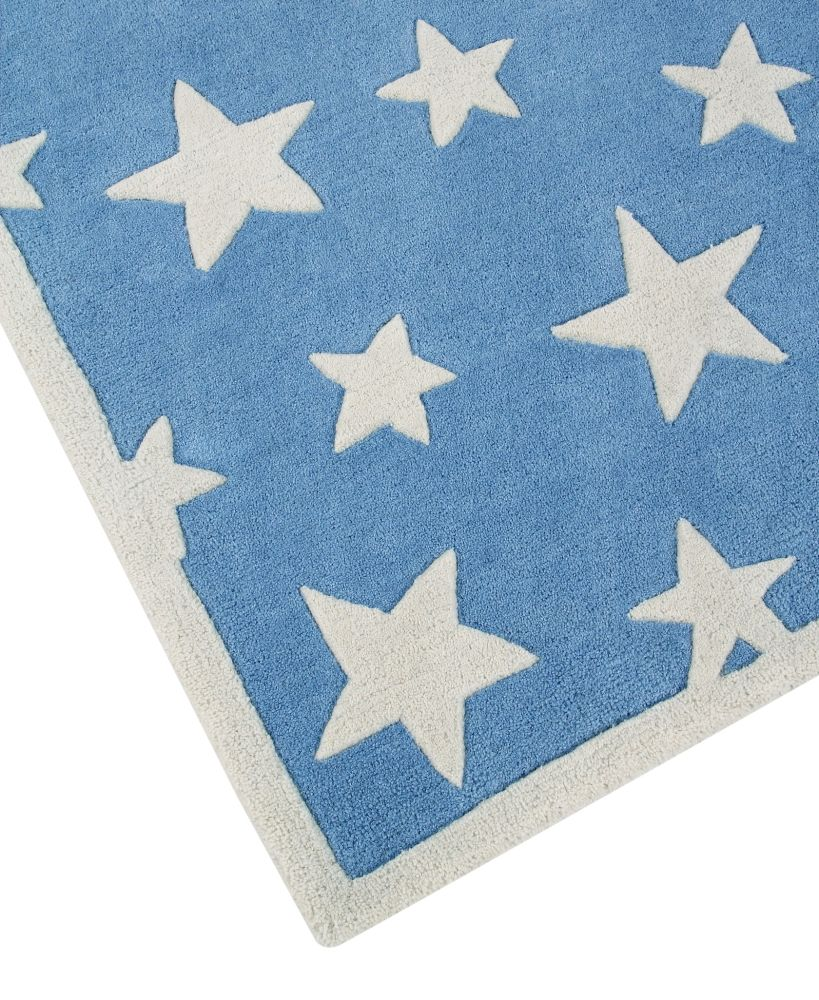 https://res.cloudinary.com/clippings/image/upload/t_big/dpr_auto,f_auto,w_auto/v1524680280/products/twinkling-stars-childrens-wool-rug-ana-noush-clippings-10094401.jpg