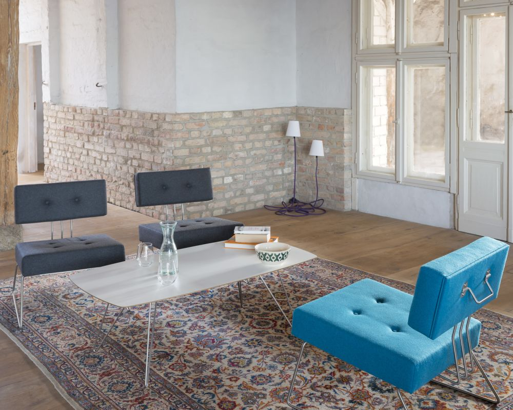 brick,building,coffee table,couch,floor,flooring,furniture,house,interior design,living room,property,room,table,tile,turquoise,wall
