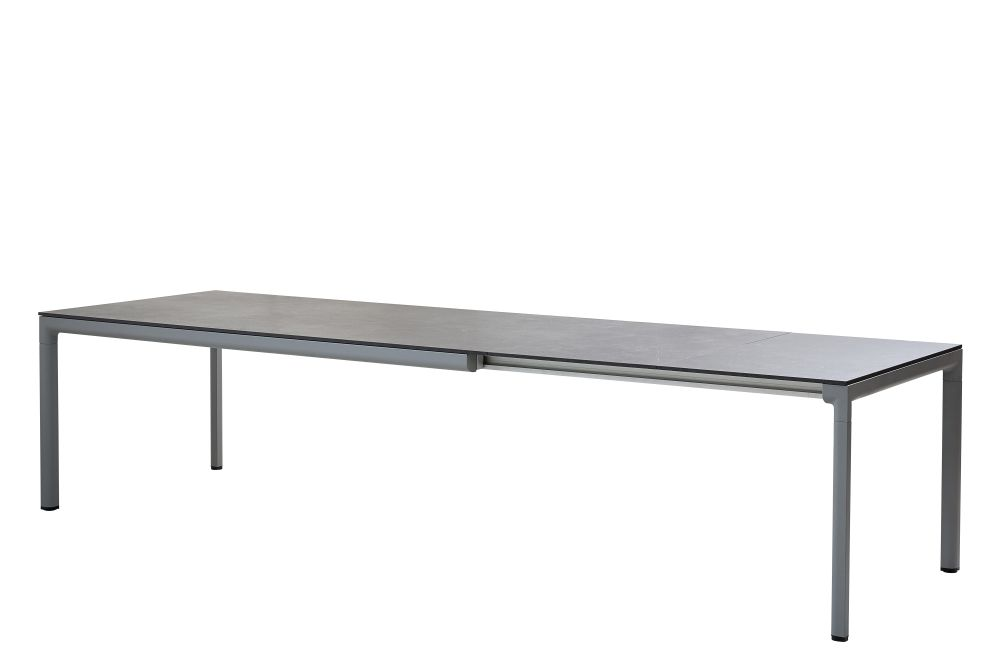 https://res.cloudinary.com/clippings/image/upload/t_big/dpr_auto,f_auto,w_auto/v1575288768/products/drop-rectangular-200x100-dining-table-with-120-extension-cane-line-cane-line-design-team-clippings-11331221.jpg