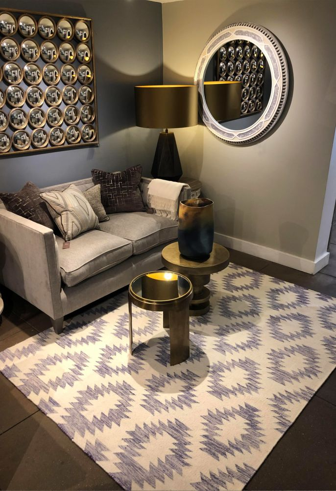 blue geometric rug in living room