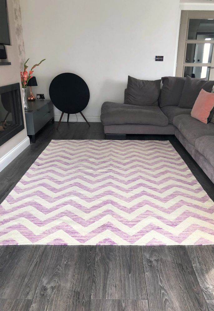purple geometric rug in room