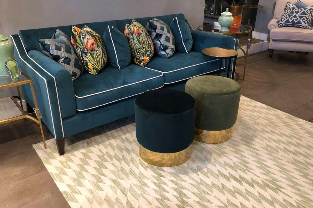 green geometric rug in living room