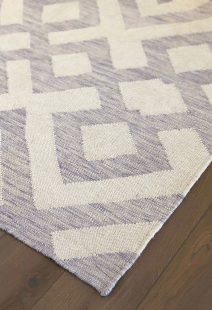 purple geometric rug corner view
