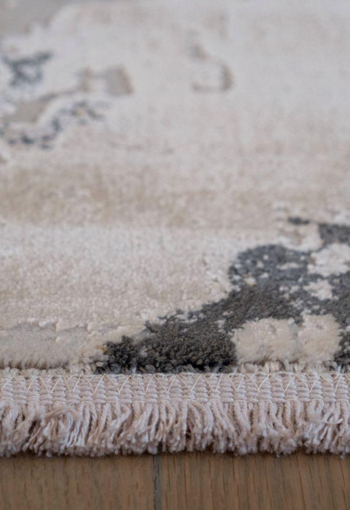 grey abstract rug fringe