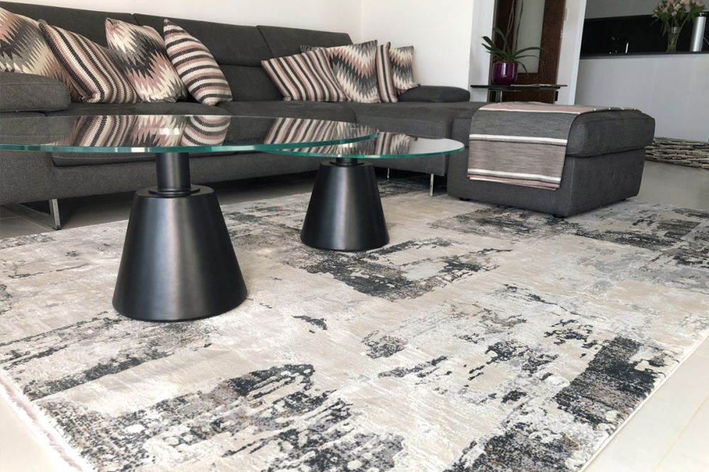 grey abstract rug in living room