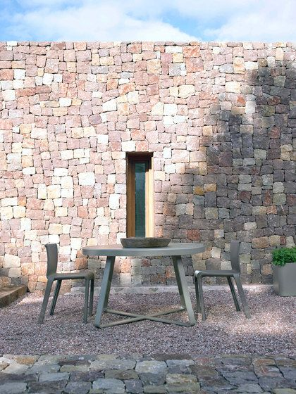GANDIABLASCO,Dining Chairs,bench,brick,brickwork,chair,furniture,property,stone wall,table,wall