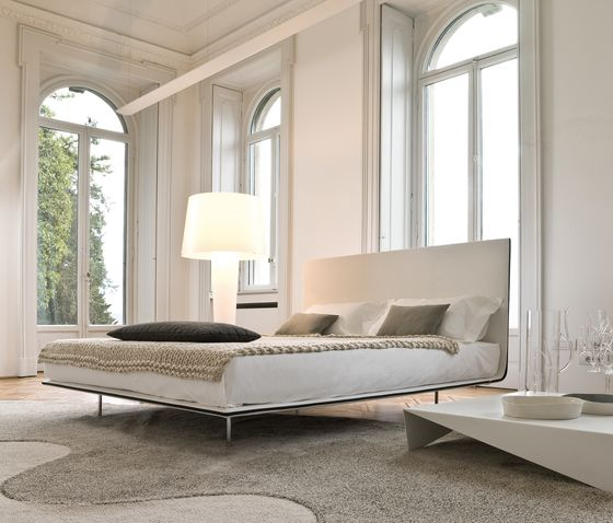 architecture,bed,bed frame,bedroom,chaise longue,couch,floor,furniture,interior design,mattress,property,room,studio couch,table,white