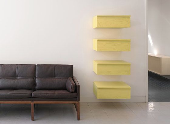 BassamFellows,Bookcases & Shelves,couch,floor,furniture,interior design,living room,room,shelf,table,wall,yellow