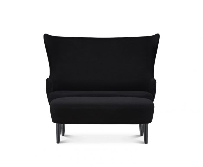 https://res.cloudinary.com/clippings/image/upload/t_big/dpr_auto,f_auto,w_auto/v2/products/wingback-sofa-black-hero-101-tom-dixon-clippings-8811681.jpg