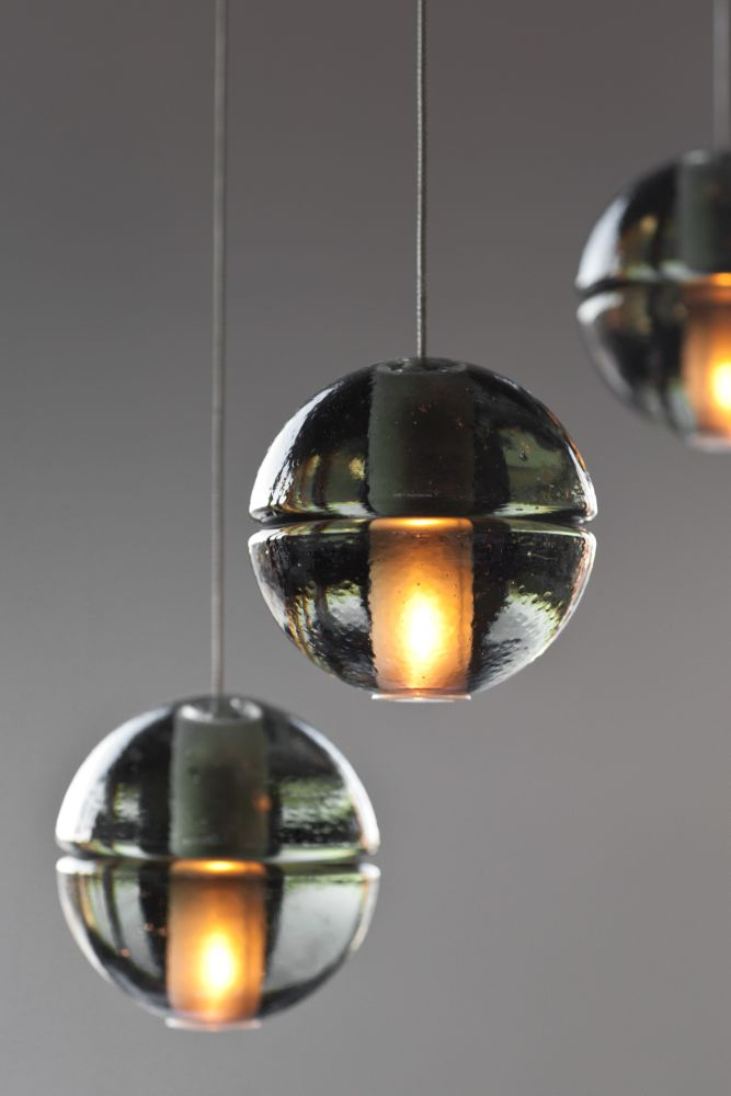 143 three pendant chandelier clear xenon by omer arbel for bocci 14 is an articulated cast glass sphere with a frosted cylindrical void that houses either a low voltage xenon or led lamp individual pendants are visually aloadofball Choice Image