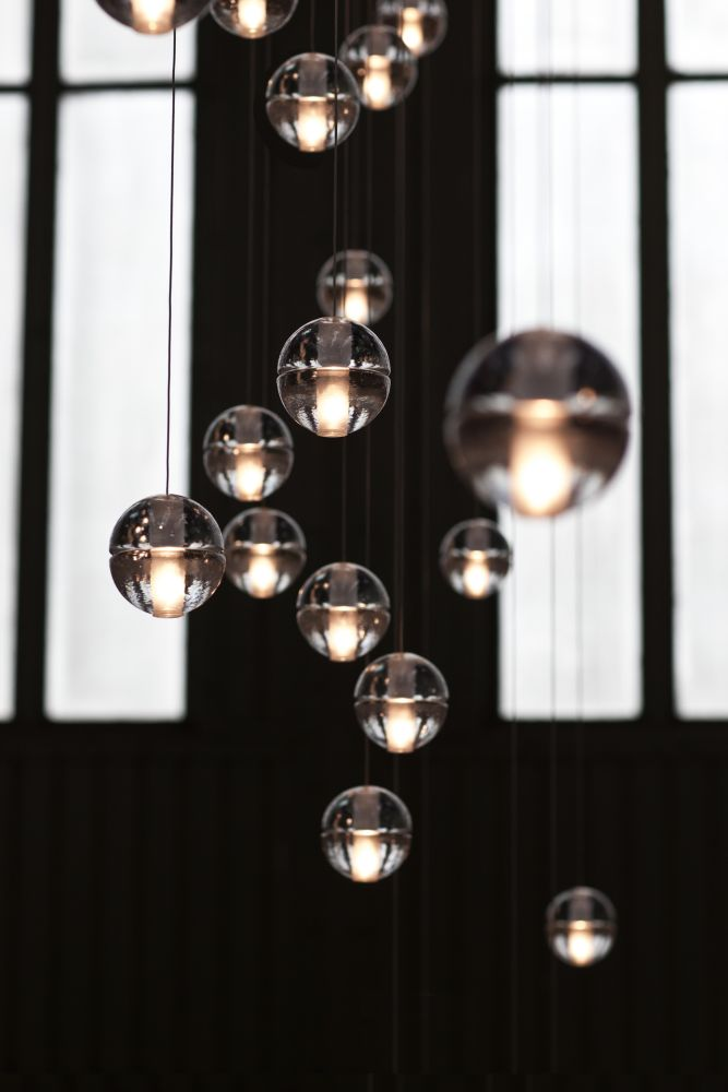 bocci lighting. unique bocci 14 is an articulated cast glass sphere with a frosted cylindrical void  that houses either lowvoltage xenon or led lamp individual pendants are visually  inside bocci lighting