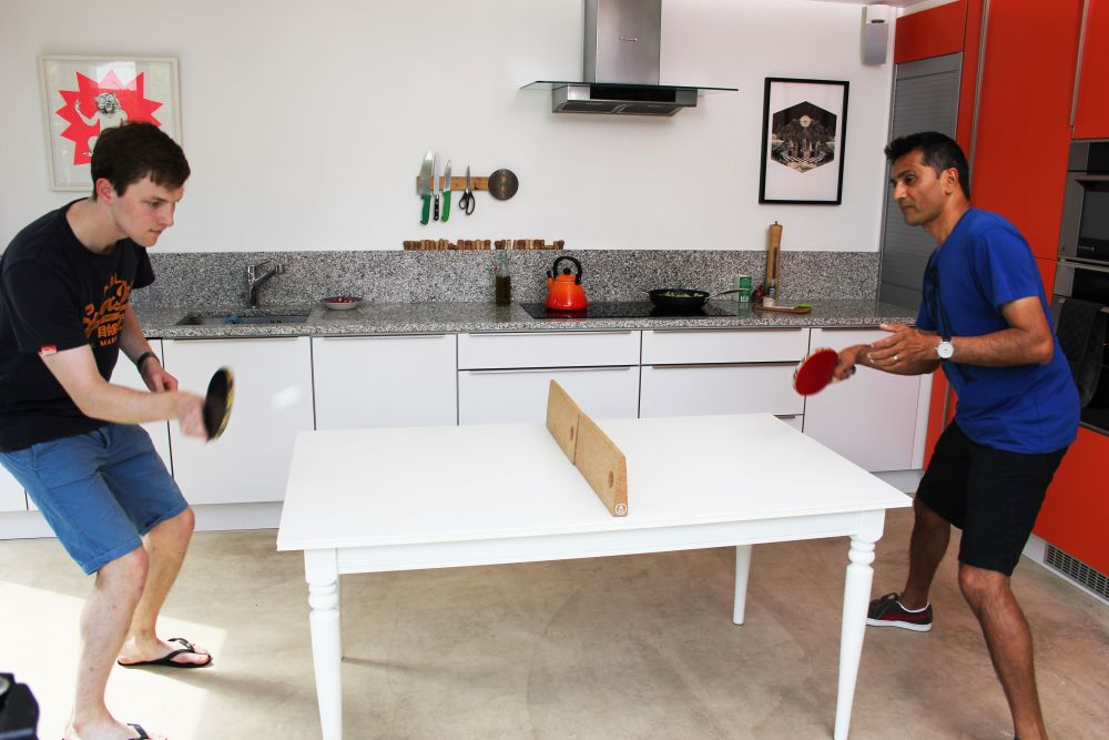 A game of kitchen table tennis