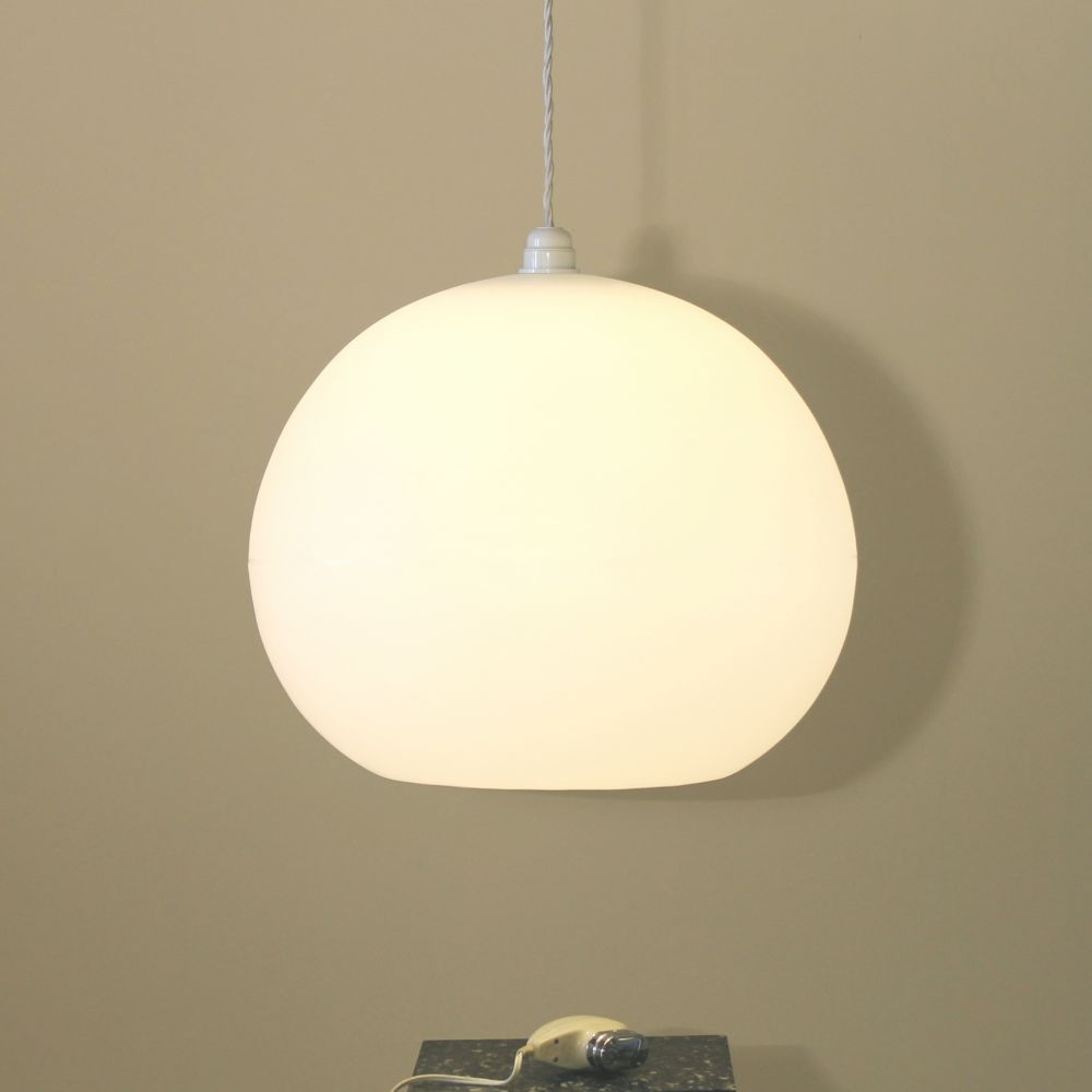 Polly Inverse Pendant lighting above a chair
