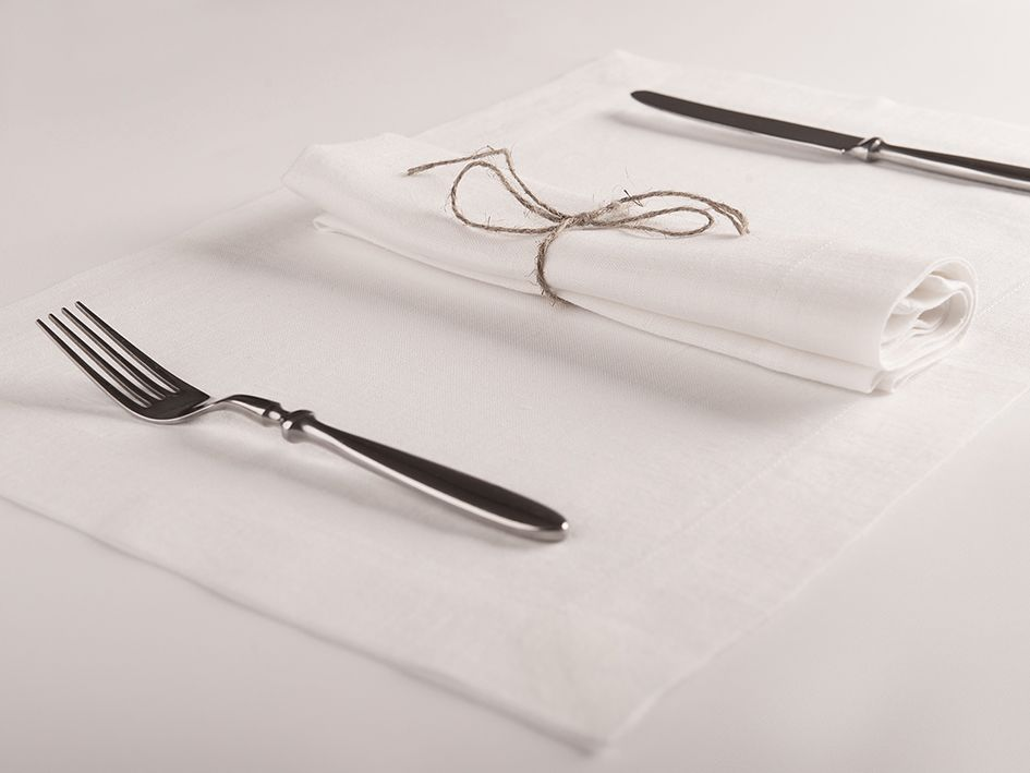 White linen table napkin and placemat