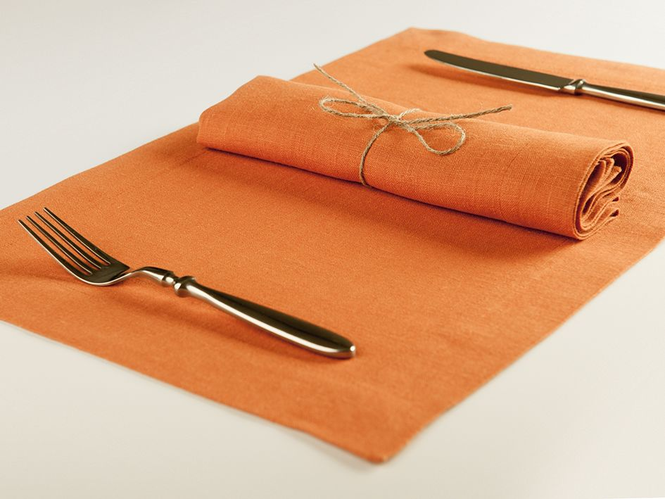 Rust linen table napkin and placemat