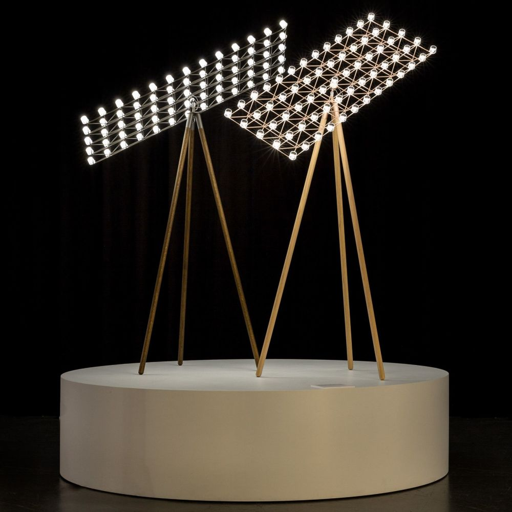 Captivating Its Frame, A Geometrical Net Of Light Metal Wires And Transparent Lights,  Can Rotate And Move In Space With The Fluent Lightness Of A Satellite, ...