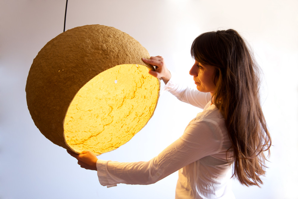 Maria showing Jupiter- ocher paper pulp lamp