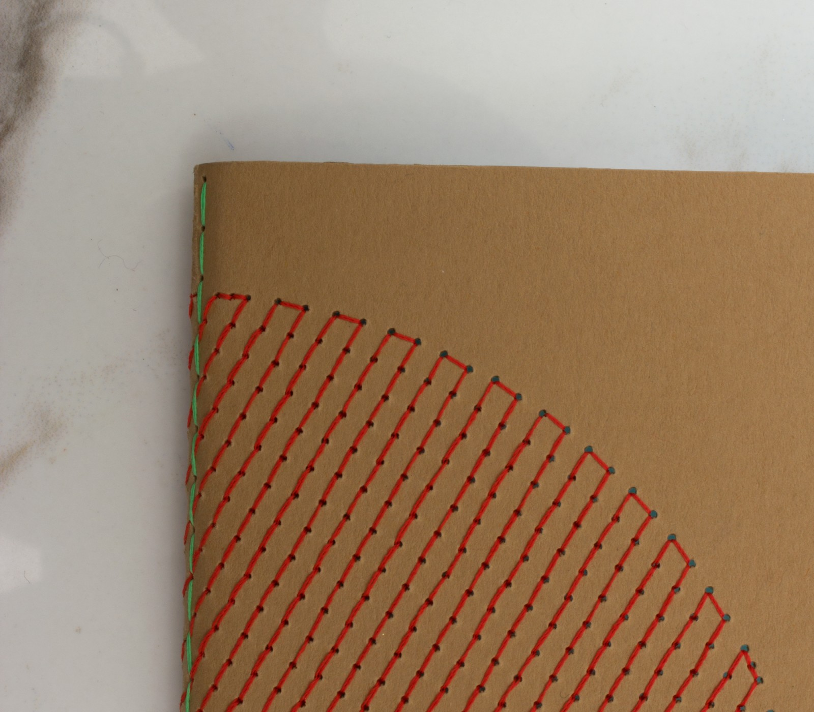 EMBROIDERED NOTEBOOK RED POCKET SIZE