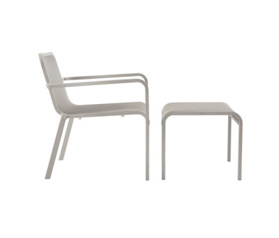 Helios chair with footstool/sidetable by Manutti