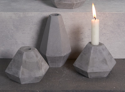 Grey concrete geometric candle holders by Korridor