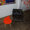 Orange Comma with vintage leather chair