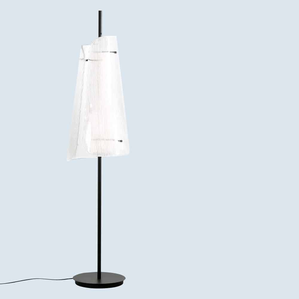 Bent floor light by Pulpo with a textured glass shade