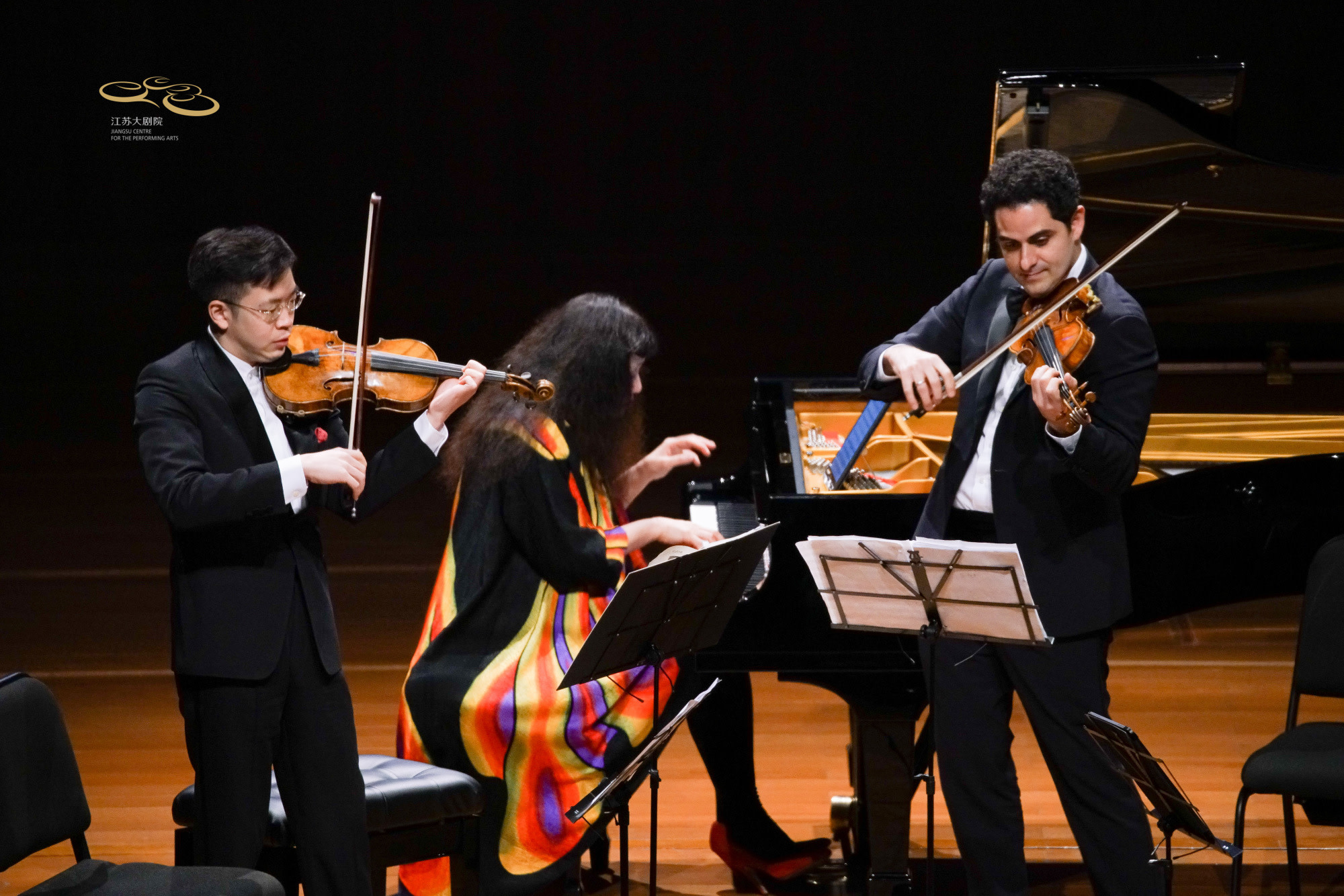 Violinist Paul Huang, pianist Wu Han, violinist Arnaud Sussmann perform at the Jiangsu Centre for the Performing Arts in Nanjing, China.