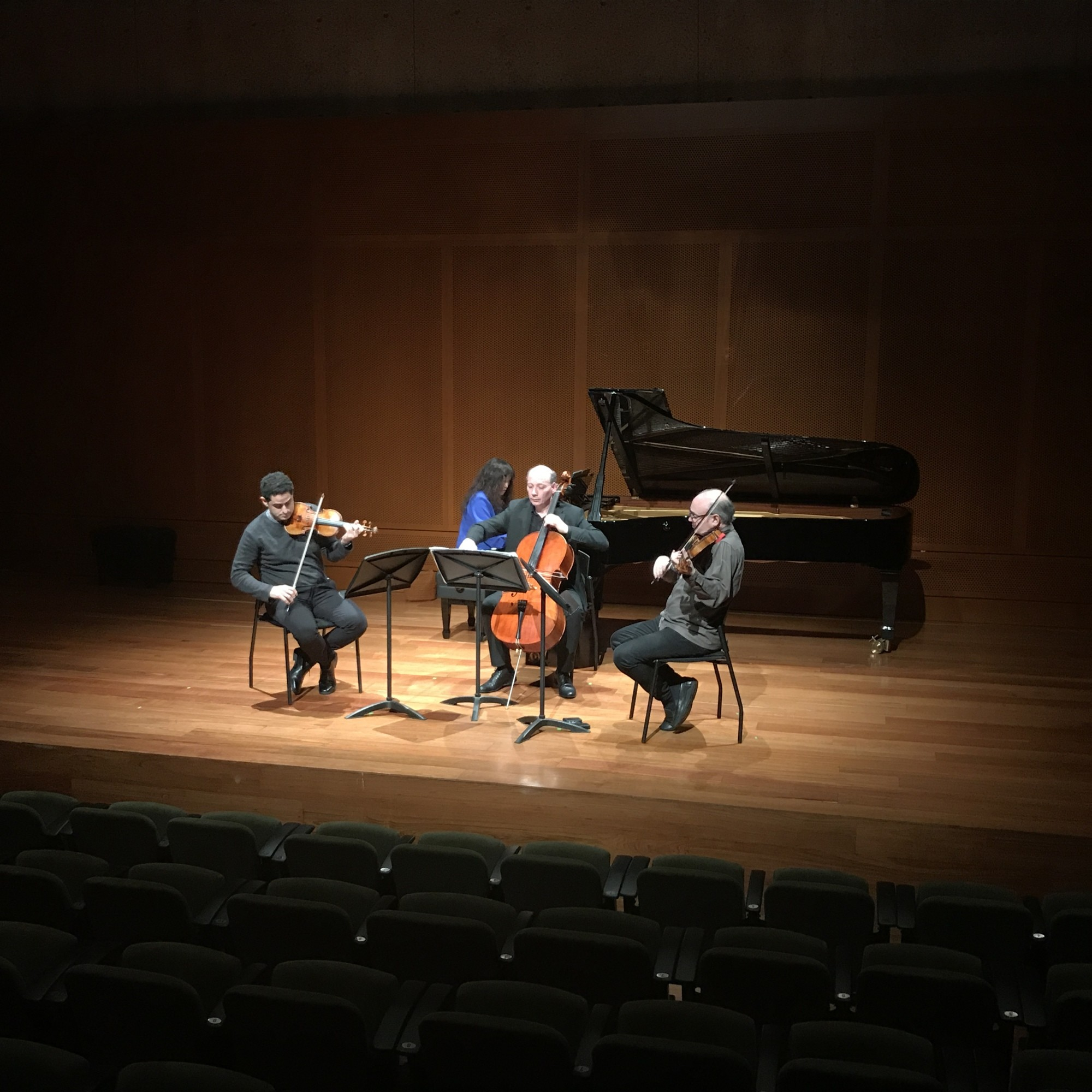 Violinist Arnaud Sussmann, pianist Wu Han, cellist Clive Greensmith, and violist Paul Neubauer rehearse.