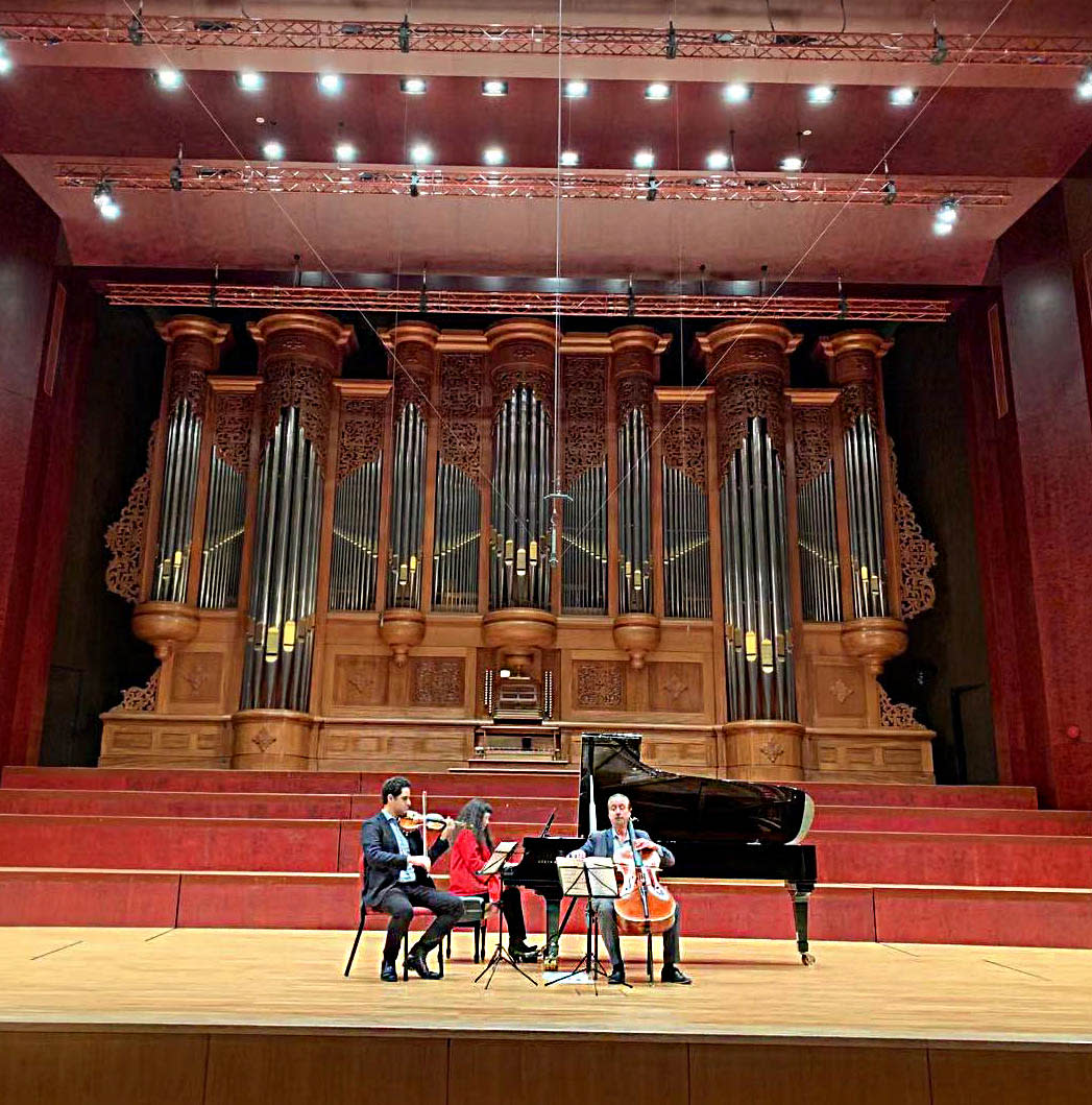 Violinist Arnaud Sussman, pianist Wu Han, and cellist David Finckel rehearse in the National Concert Hall in Taipei.