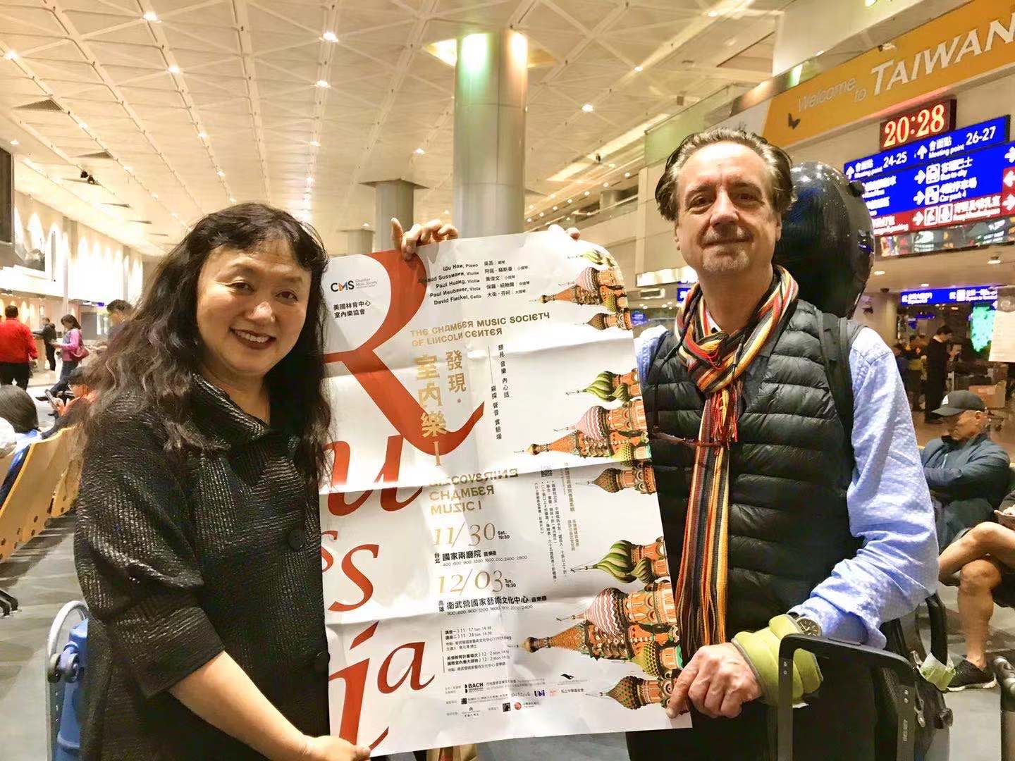Co-Artistic Directors David Finckel and Wu Han with a CMS poster in Taipei.