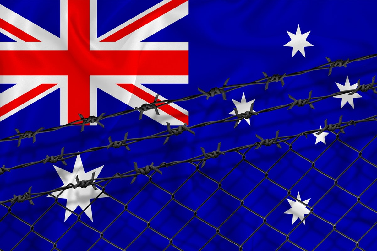 The Australian flag covered in barbed wire.