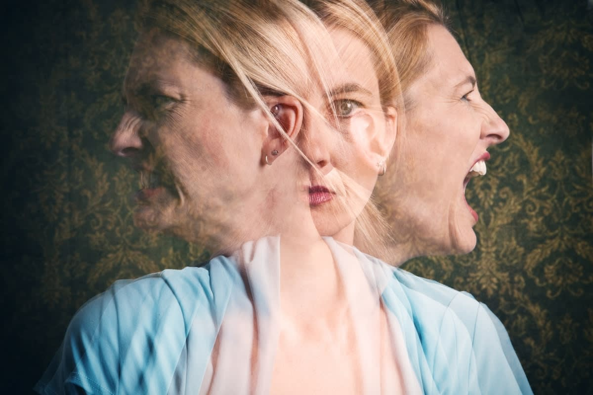Three blurred faces of the same woman undergoing mental turmoil