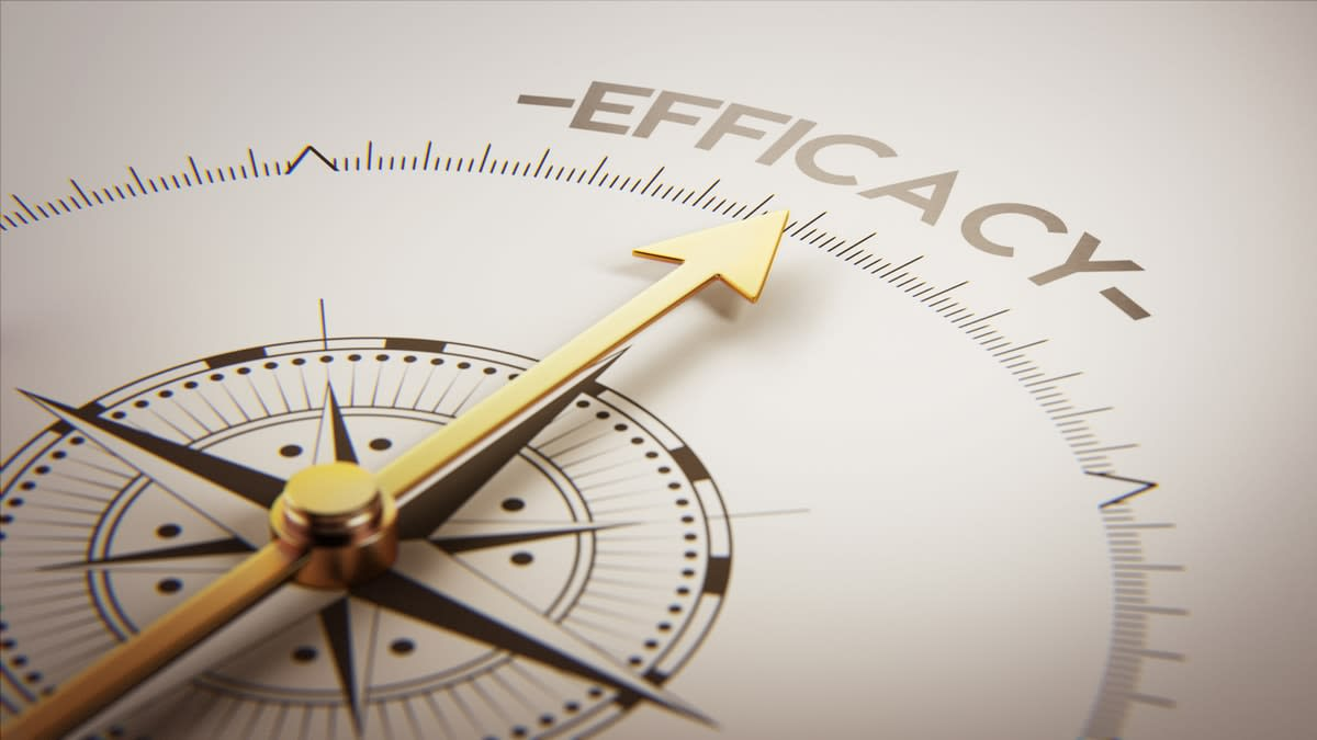 A compass with the needle pointing to the word 'efficacy'