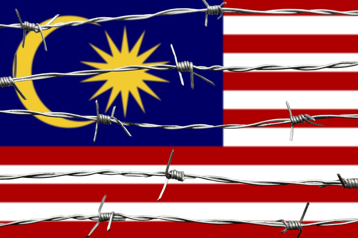 Malaysian flag with barbed wire over it