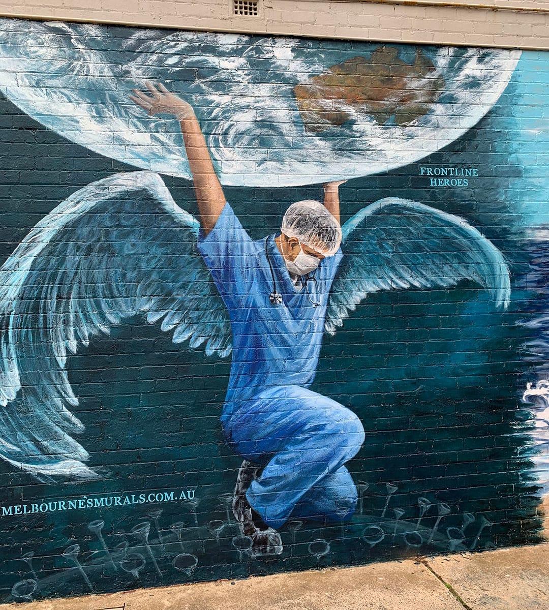 street art of nurse holding up world, Melbournes murals - Black Rock
