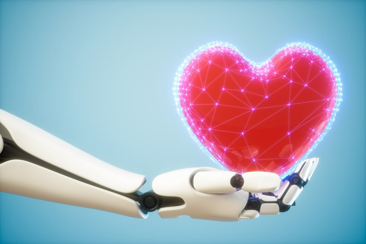 A white robot hand holding a digitalised red heart