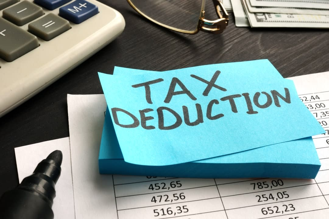 Tax deduction written on a piece of paper