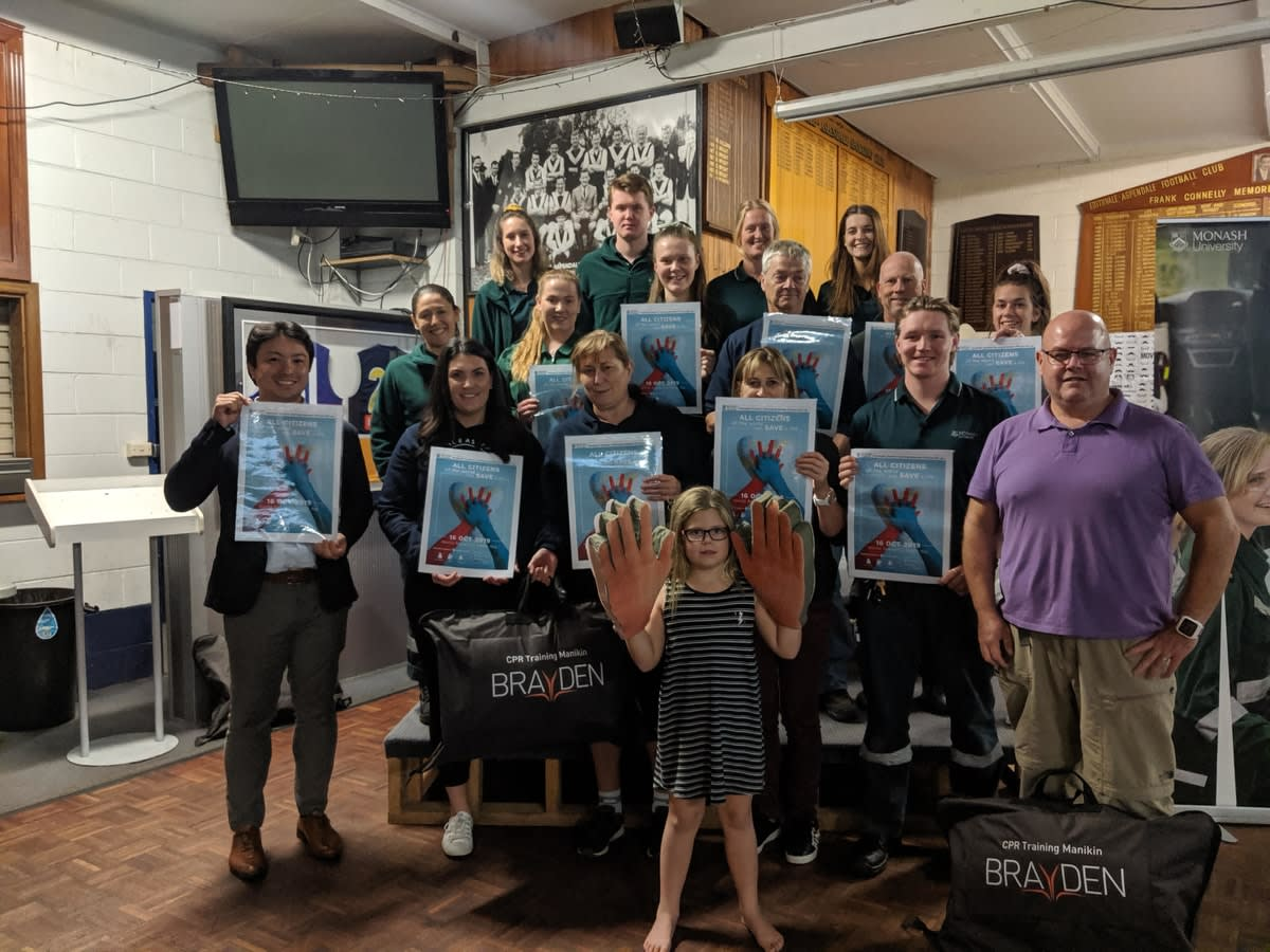 Paramedicine students and Edithvale netball club members smiling and displaying their CPR course certificates