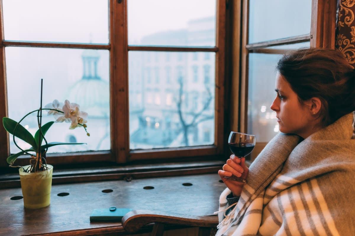 woman in pandemic lockdown drinking wine